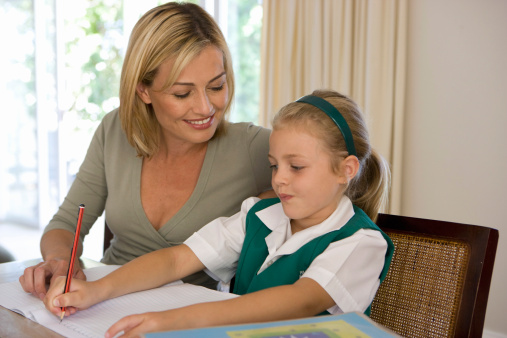Mother helping daughter with homework, Cape Town, Western Cape Province, South Africa