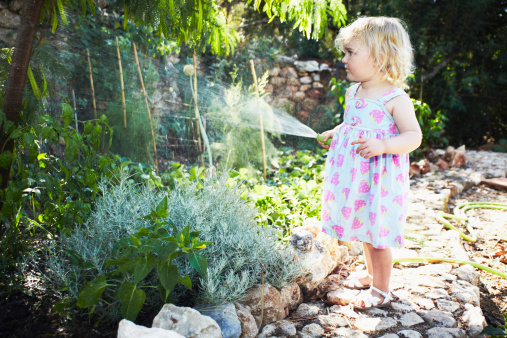 Portrait of a Young girl gardening