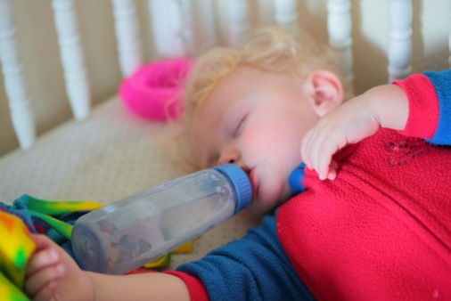 Empty Bottle Sleeping Baby In Crib