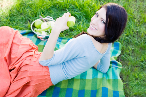 Stylish Woman in 20's Eating Green Apple
